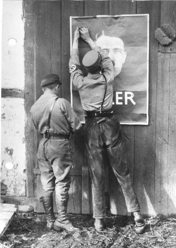 putting-up-hitler-poster